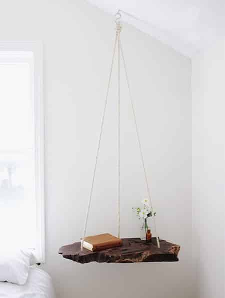 A galvanised steel tray with decorative edging is turned upside down for a pretty hanging table